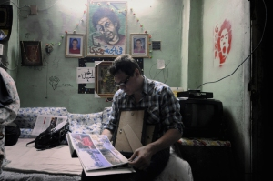 McCallany in the bedroom of slain April 6 member Gika.