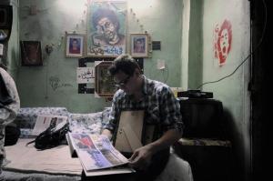 McCallany in the bedroom of slain April 6 member Gika.